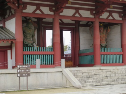 The two statues in this picture are called Nio statues, are entirely made out of wood, and protect the temple.