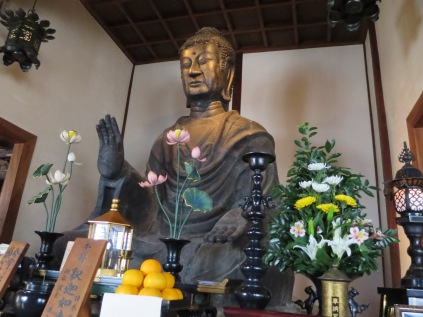 This is the Asuka Daibutsu. While much smaller than the Daibutsu in the Todaiji, it is much older (built in the early seventh century). Also unlike the Todaiji Daibutsu, this one is the same statue. It has never been broken or repaired. The guide told us all about this statue and said that it has been in the exact same location for over 1000 years! The building hasn't always been there and so for a time the Great Buddha was battered by the elements, but it has always been worshiped.