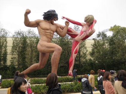 Models of two titans fighting from Attack on Titan