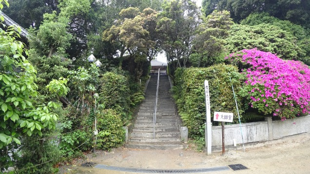 A set of stairs leading up to another temple